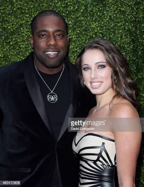 Football player Brian Banks and Emmy Marino attend the HollyRod Foundation's 16th Annual DesignCare at The Lot Studios on July 19 2014 in Los Angeles...