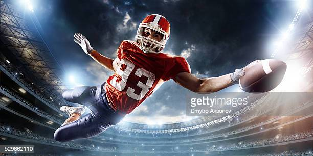 football player catches a ball - wide receiver athlete stock pictures, royalty-free photos & images