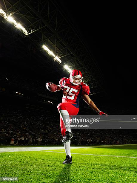 Football player celebrating in end zone