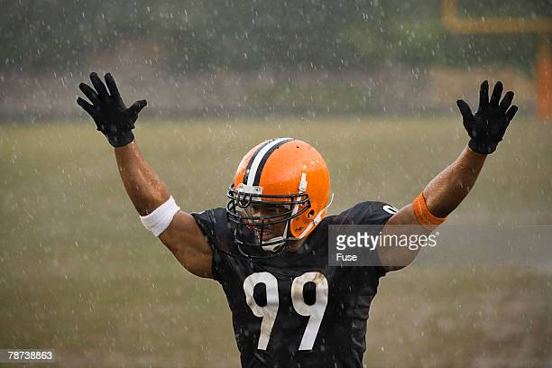 football player celebrating play - defensive tackle american football player stock pictures, royalty-free photos & images