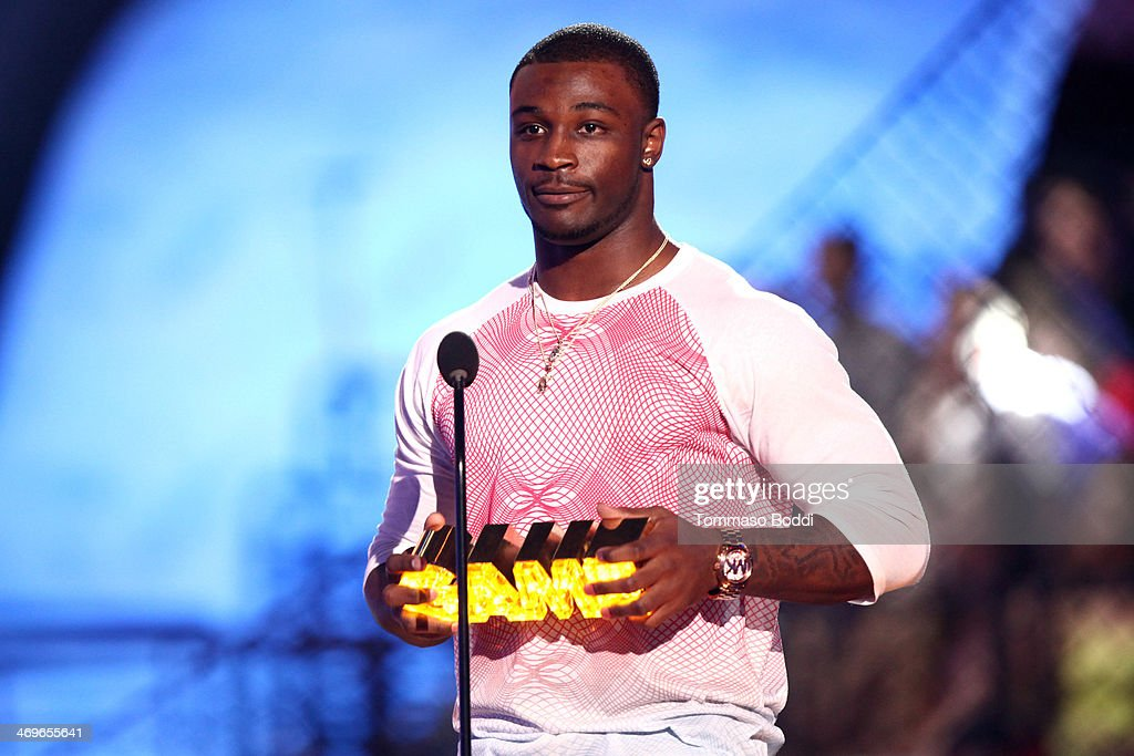 Football player Chris Davis accepts the Whoa-ment award onstage during the 4th Annual Cartoon Network Hall Of Game Awards held at the Barker Hangar on February 15, 2014 in Santa Monica, California.