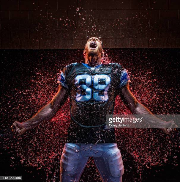 football player clenching fist - explosive stock pictures, royalty-free photos & images