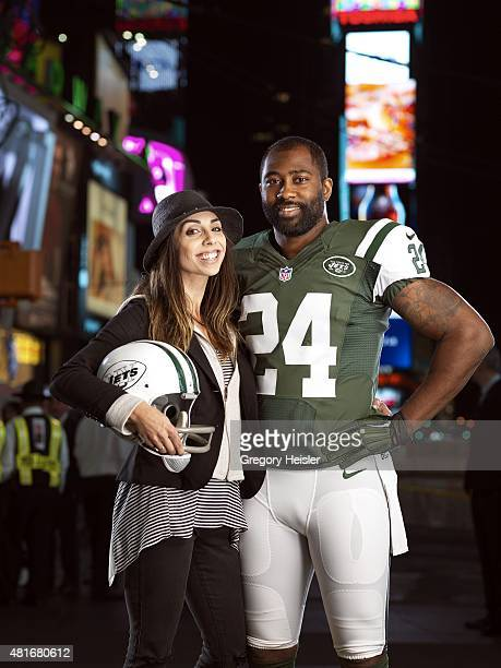 Football player Darrelle Revis is photographed with Jessica Namath for Sports Illustrated on May 6 2015 in Time Square in New York City CREDIT MUST...