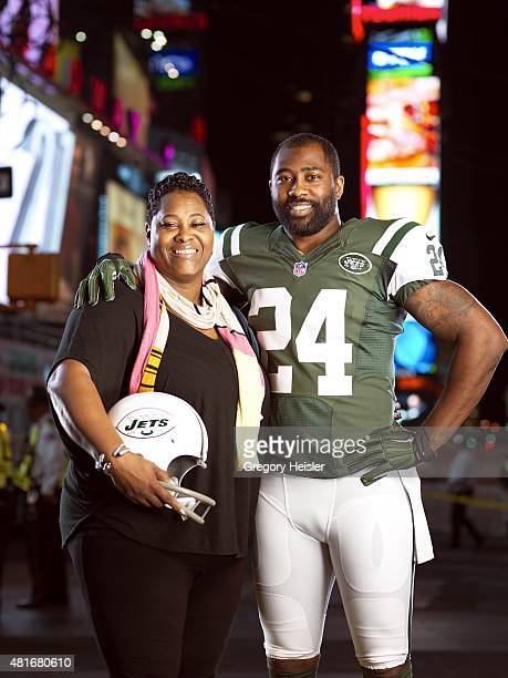 Football player Darrelle Revis is photographed with mother Diana Gilbert for Sports Illustrated on May 6, 2015 in Time Square in New York City....