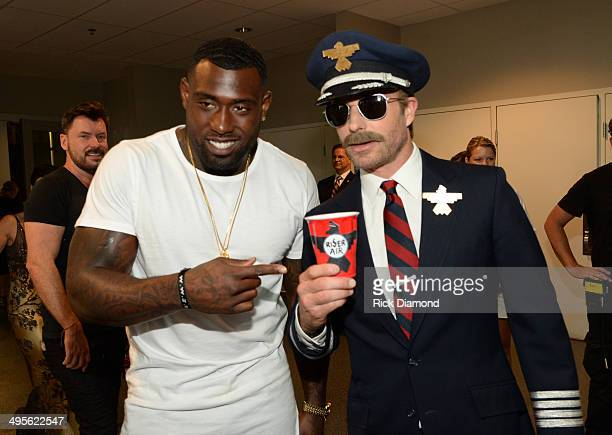 Football player Delanie Walker and Dierks Bentley attend the 2014 CMT Music Awards at Bridgestone Arena on June 4 2014 in Nashville Tennessee