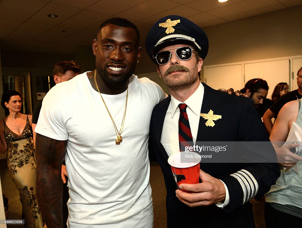 Football player Delanie Walker and Dierks Bentley attend the 2014 CMT Music Awards at Bridgestone Arena on June 4, 2014 in Nashville, Tennessee.