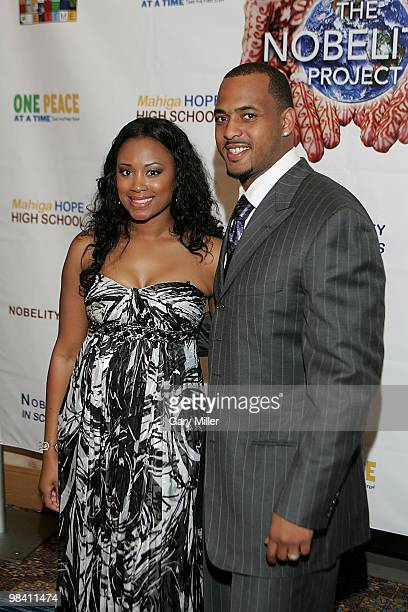 Football player Derrick Johnson of the Kansas City Chiefs and wife Tamika Johnson psoe on the red carpet for the Nobelity Project's dinner honoring...