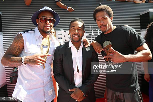 NFL football player DeSean Jackson singer Omarion and actor Nick Cannon attend the BET AWARDS '14 at Nokia Theatre LA LIVE on June 29 2014 in Los...
