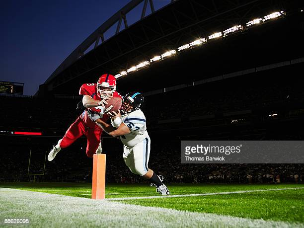 Football player diving into end zone
