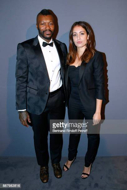 Football player Djibril Cisse and actress Hiba Abouk attend the Annual Charity Dinner hosted by the AEM Association Children of the World for Rwanda...
