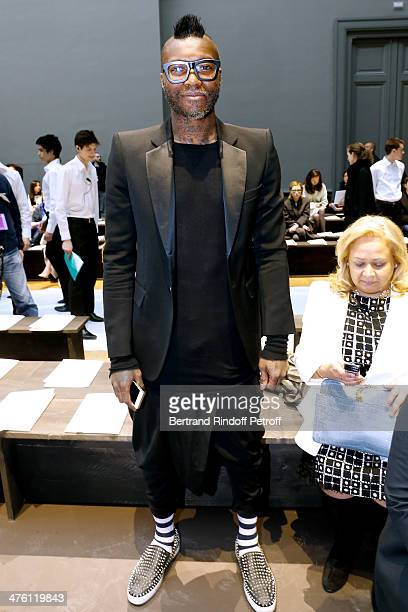 Football player Djibril Cisse attends the Chloe show as part of the Paris Fashion Week Womenswear Fall/Winter 20142015 Held at Grand Palais on March...