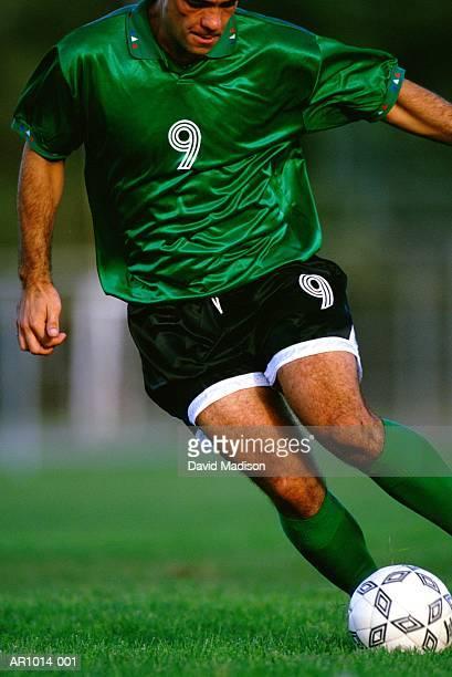 football player dribbling ball, close-up - ドリブル ストックフォトと画像