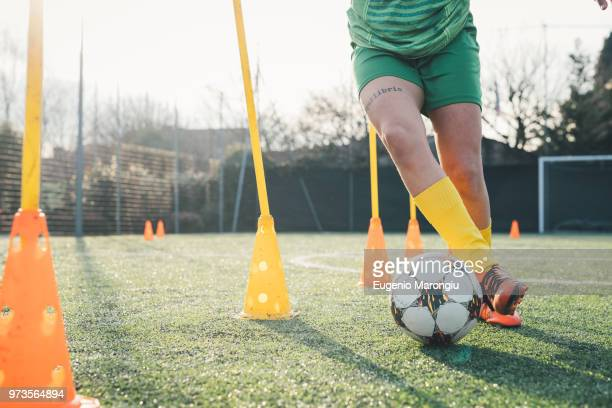 football player dribbling ball - dribbling sports stock pictures, royalty-free photos & images