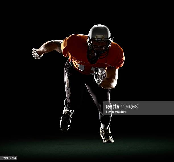 football player exploding from 3-point stance - rush american football stock pictures, royalty-free photos & images