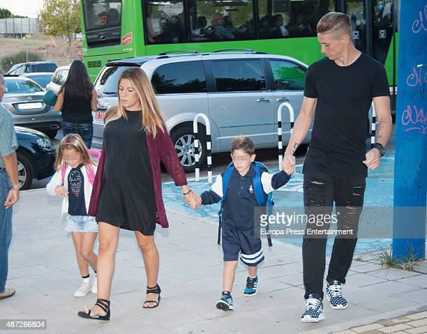 Football player Fernando Torres and Olalla Dominguez bring their son Leo Torres and Nora Torres to school on September 7 2015 in Madrid Spain