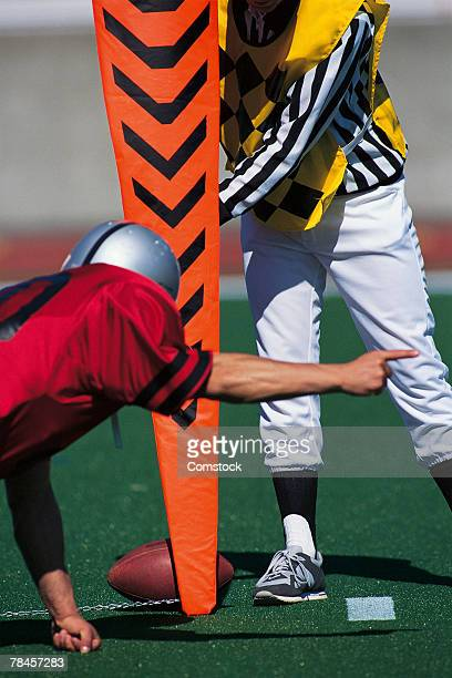 Football player gesturing first down