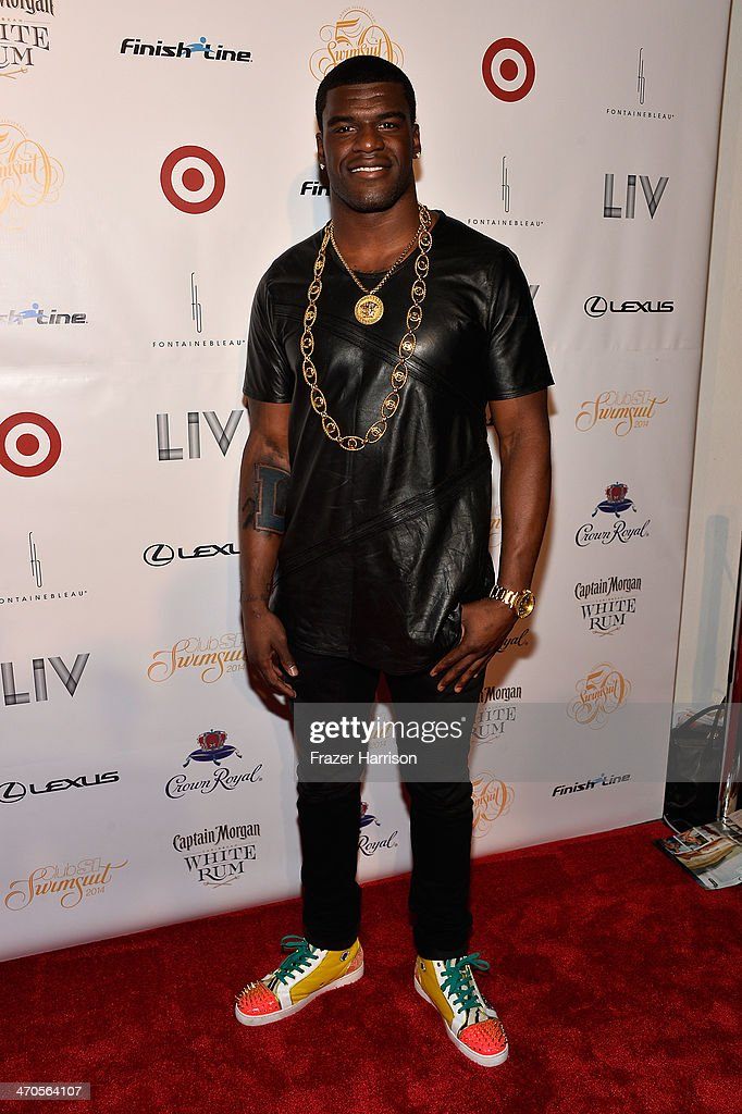 Football player Greg Little attends Club SI Swimsuit at LIV Nightclub hosted by Sports Illustrated at Fontainebleau Miami on February 19, 2014 in Miami Beach, Florida.