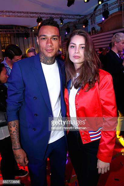 Football player Gregory van der Wiel and Model MarieAnge Casta attend Tommy Hilfiger Hosts Tommy X Nadal Party Cocktail on May 18 2016 in Paris