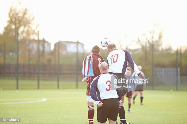 football player heading ball - heading stock pictures, royalty-free photos & images