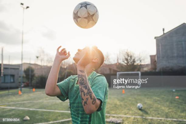 Football player heading ball