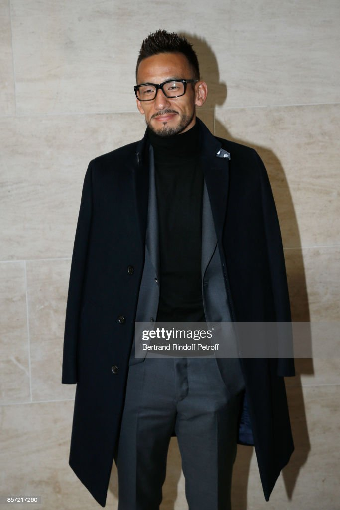 Football player Hidetoshi Nakata attends the Louis Vuitton show as part of the Paris Fashion Week Womenswear Spring/Summer 2018 on October 3, 2017 in Paris, France.
