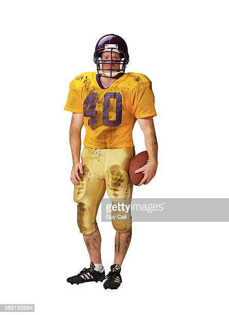 football player holding ball - american football uniform stock pictures, royalty-free photos & images