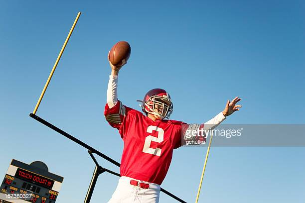 a football player in a red jersey after a touchdown - gchutka stock pictures, royalty-free photos & images