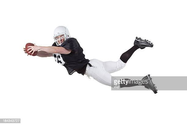 football player in action - american football strip stock pictures, royalty-free photos & images