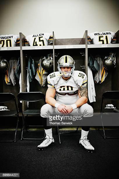 Football player in locker room before game