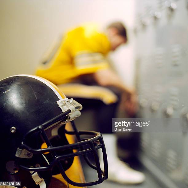 football player in locker room - safety american football player stock pictures, royalty-free photos & images