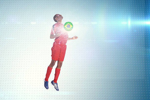 Composite image of football player in red jumping
