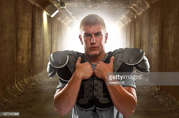 football player in the tunnel - padding stock pictures, royalty-free photos & images