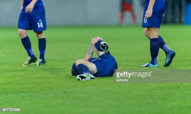 football player injured - low section stock pictures, royalty-free photos & images