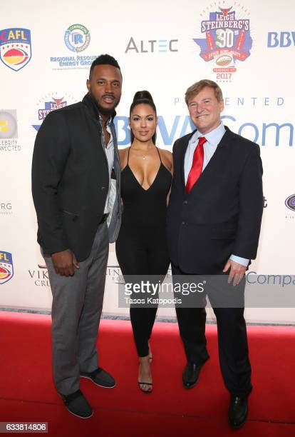 Football player James Anderson, Carissa Rosario, and sports agent/event host Leigh Steinberg attend the 30th Annual Leigh Steinberg Super Bowl Party...