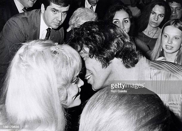 Football player Joe Namath and date Randi Oakes attending the premiere party for 'CC Ryder and Company' on October 13 1970 at Bachelor's Three in New...