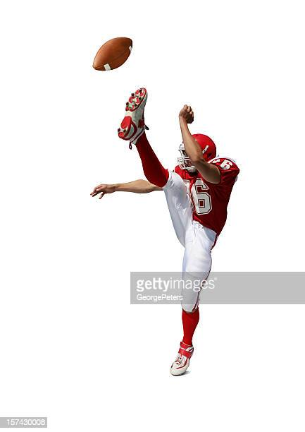 football player kicking ball with clipping path - kicking stock pictures, royalty-free photos & images