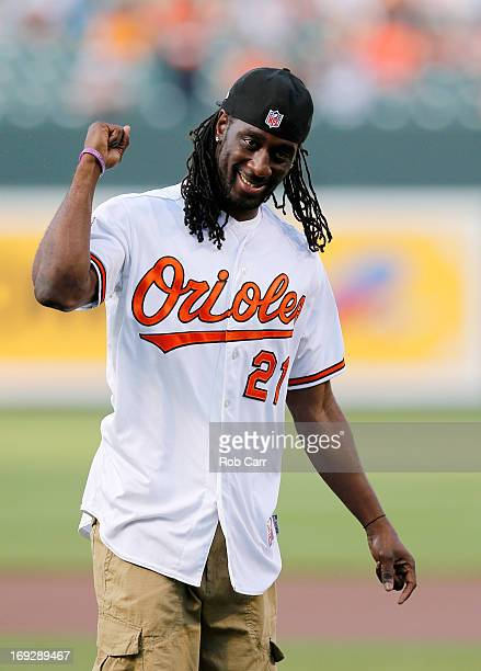 Football player Lardarius Webb of the Baltimore Ravens reacts after throwing out the ceremional first pitch before the start of the Baltimore Orioles...