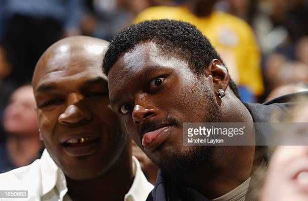 Football player LaVar Arrington and boxer Mike Tyson attend the game between the Los Angeles Lakers and the Washington Wizards at the MCI Center on...