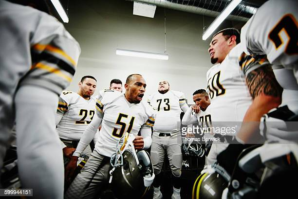 football player leading team motivational chant - chanting stock pictures, royalty-free photos & images
