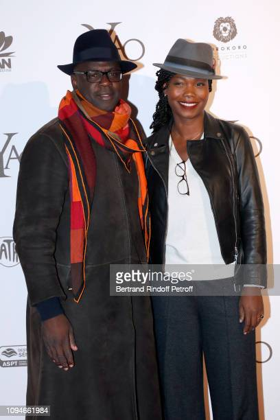 Football player Lilian Thuram and his companion journalist Kareen Guiock attend the YAO Paris Premiere at Le Grand Rex on January 15 2019 in Paris...