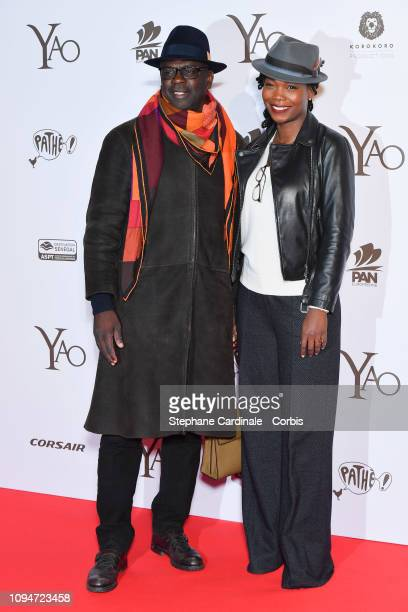 Football player Lilian Thuram and his companion journalist Kareen Guiock attend Yao Paris Premiere at Le Grand Rex on January 15 2019 in Paris France