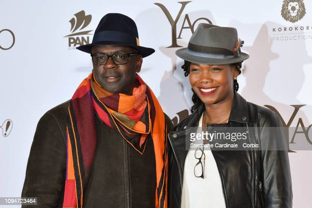 Football player Lilian Thuram and his companion journalist Kareen Guiock attend 'Yao' Paris Premiere at Le Grand Rex on January 15 2019 in Paris...