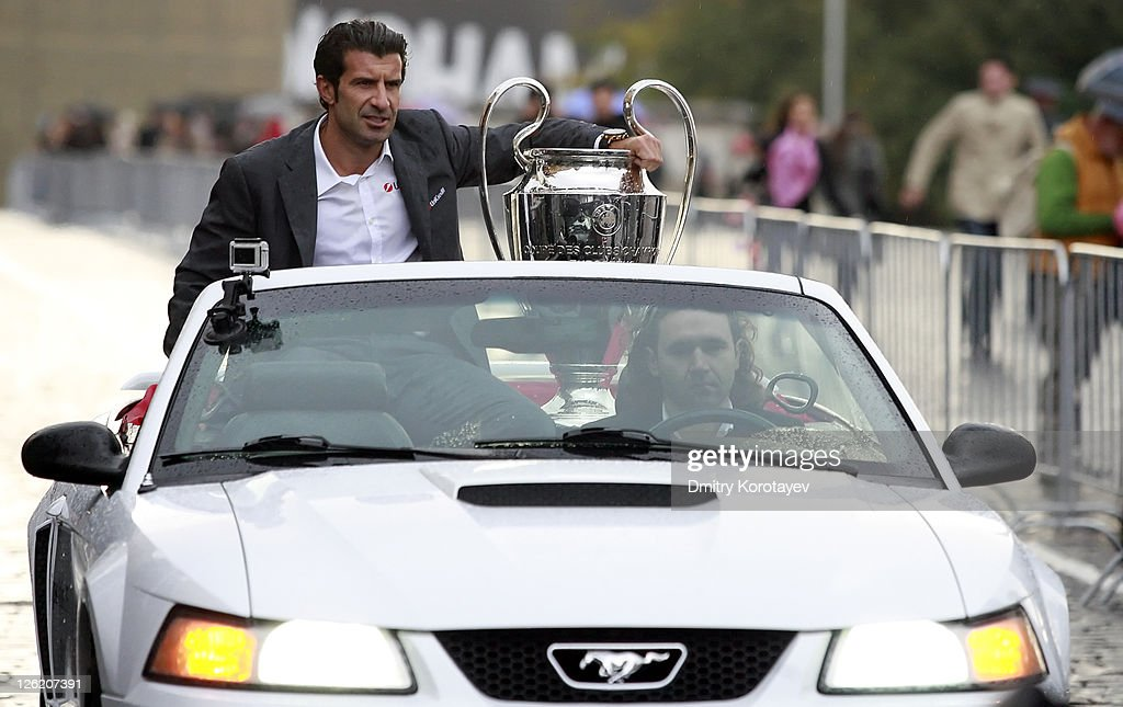 Football player Luis Figo holds the trophy during the UEFA Champions League Trophy Tour 2011 on September 23, 2011 in Moscow, Russia.