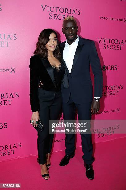 Football player Mamadou Sakho and his wife Majda attend the 2016 Victoria's Secret Fashion Show Held at Grand Palais on November 30 2016 in Paris...