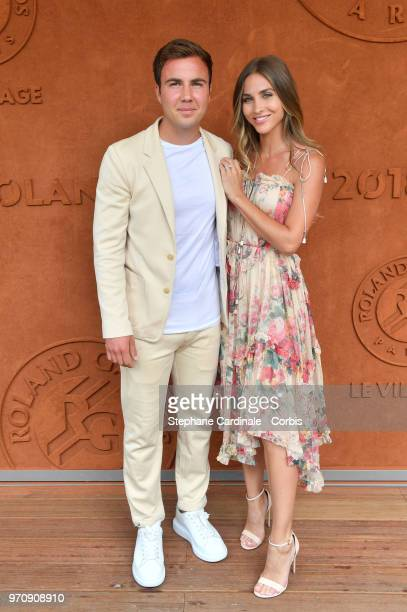 Football player Mario Gotze and his companion AnnKathrin Brommel attend the Men Final of the 2018 French Open Day Fithteen at Roland Garros on June...