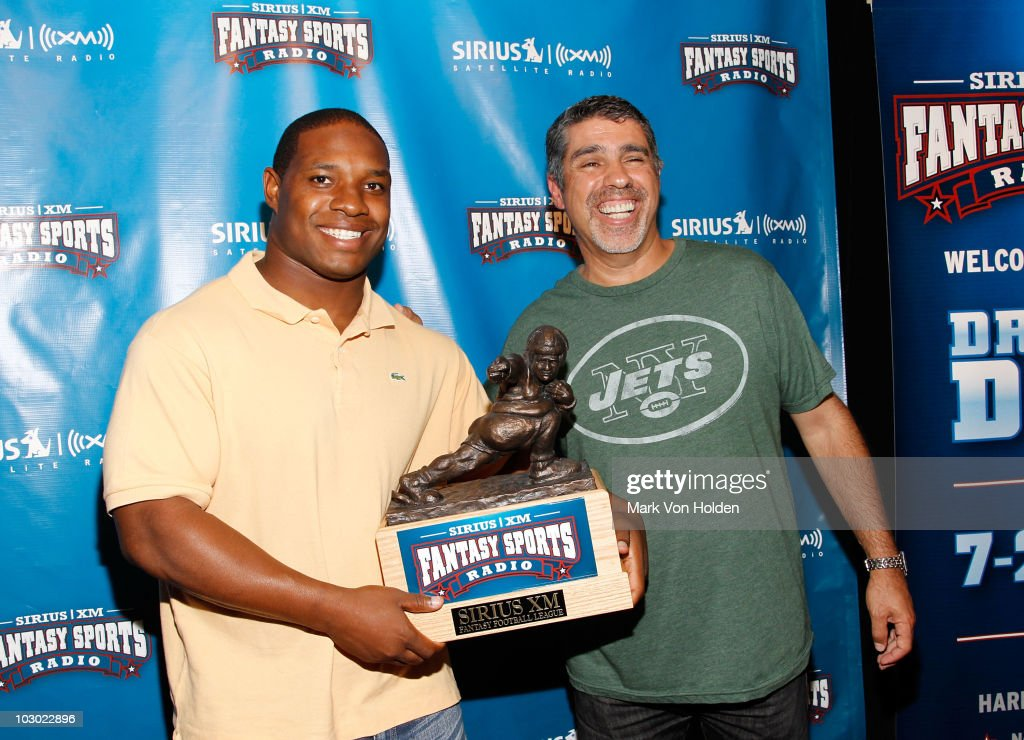 Football player Maurice Jones-Drew and Executive producer of the Howard Stern Show Gary Dell'Abate attend the SIRIUS XM Radio celebrity fantasy football draft at Hard Rock Cafe - Times Square on July 21, 2010 in New York City.