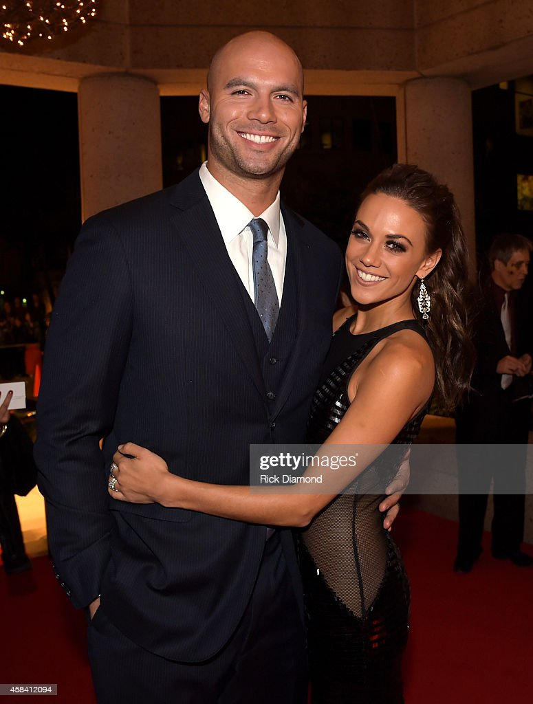 Football player Michael Caussin and singer Jana Kramer attend the BMI 2014 Country Awards at BMI on November 4, 2014 in Nashville, Tennessee.