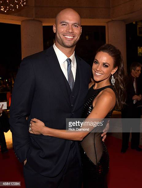 Football player Michael Caussin and singer Jana Kramer attend the BMI 2014 Country Awards at BMI on November 4 2014 in Nashville Tennessee