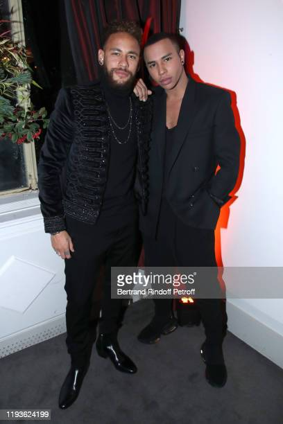 Football player Neymar Jr and stylist Olivier Rousteing attend the Annual Charity Dinner hosted by the AEM Association Children of the World for...