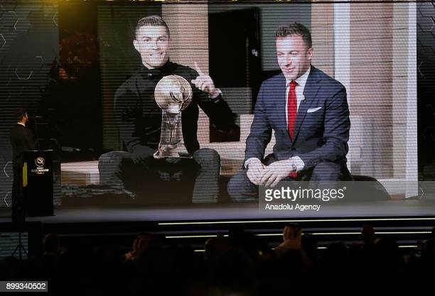 Football player of Real Madrid Cristiano Ronaldo delivers a speech via teleconference as he sits beside Italian former football player Alessandro Del...